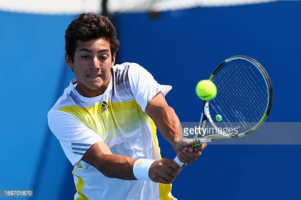 Christian Garin of Chile plays a backhand in his first round match against Takashi Saito of Japan during the 2013 Australian Open Junior...