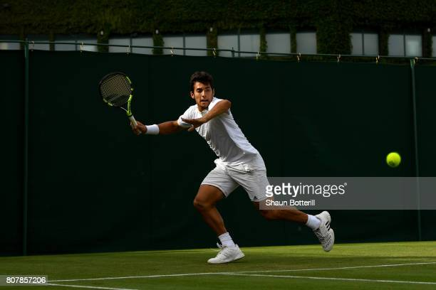 Christian Garin of Chile plays a forehand during the Gentlemen's Singles first round match against Jack Sock of The United States on day two of the...