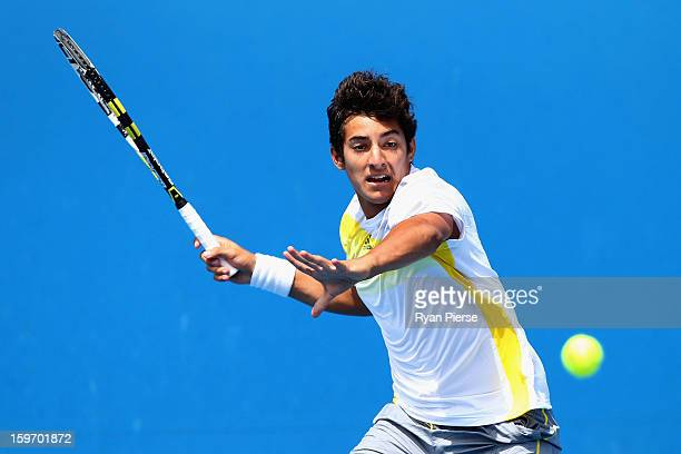 Christian Garin of Chile plays a forehand in his first round match against Takashi Saito of Japan during the 2013 Australian Open Junior...