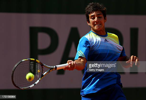 Christian Garin of Chile plays a forehand in the boys' singles final match against Alexander Zverev of Germany during day fourteen of French Open at...