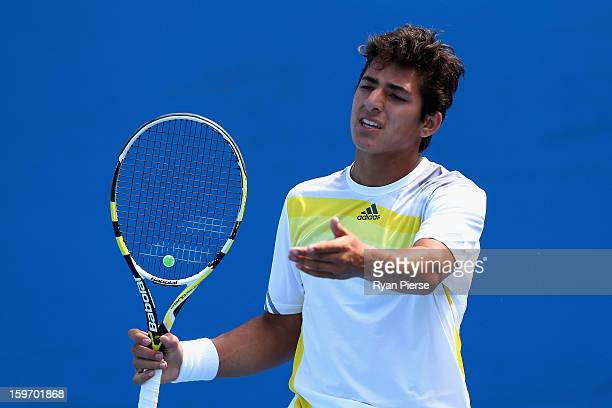 Christian Garin of Chile reacts after a point in his first round match against Takashi Saito of Japan during the 2013 Australian Open Junior...