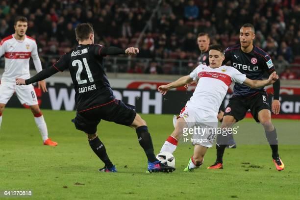 Christian Gartner of Fortuna Duesseldorfm Josip Brekalo of Stuttgart and Jerome Kiesewetter of Fortuna Duesseldorf battle for the ball during the...