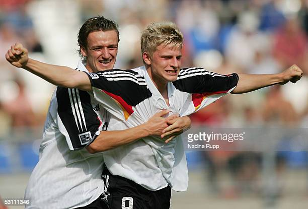 Christian Gentner of Germany celebrates Nicky Adler of Germany scoring the second goal during the FIFA World Youth Championship match between China...