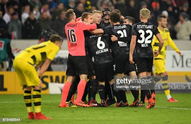 Christian Gentner of Stuttgart and his team mates celebrate after winning the Bundesliga match between VfB Stuttgart and Borussia Dortmund at...
