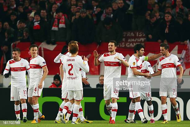 Christian Gentner of Stuttgart celebrates his team's first goal with team mates during the UEFA Europa League Round of 32 first leg match between VfB...