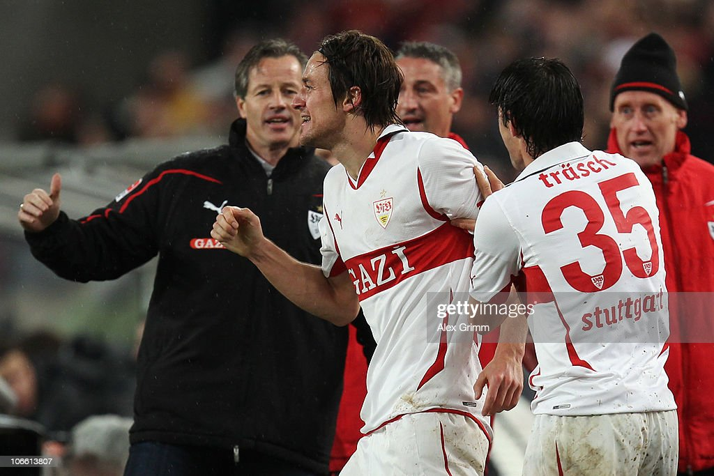 <a gi-track='captionPersonalityLinkClicked' href=/galleries/search?phrase=Christian+Gentner&family=editorial&specificpeople=228707 ng-click='$event.stopPropagation()'>Christian Gentner</a> (C) of Stuttgart celebrates his team's fourth goal with team mate <a gi-track='captionPersonalityLinkClicked' href=/galleries/search?phrase=Christian+Traesch&family=editorial&specificpeople=5482851 ng-click='$event.stopPropagation()'>Christian Traesch</a> (L) and head coach Jens Keller during the Bundesliga match between VfB Stuttgart and SV Werder Bremen at the Mercedes-Benz Arena on November 7, 2010 in Stuttgart, Germany.
