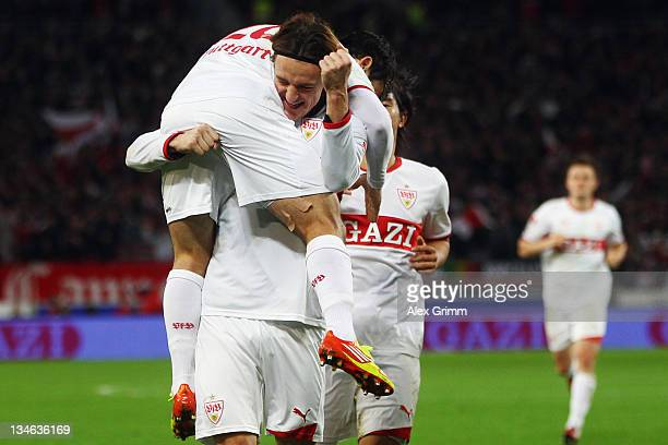 Christian Gentner of Stuttgart celebrates his team's second goal with team mates Tamas Hajnal and Shinji Okazaki during the Bundesliga match between...