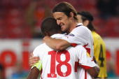 Christian Gentner of Stuttgart celebrates scoring the second team goal with his team mate Cacau during the UEFA Europa League group H match between...