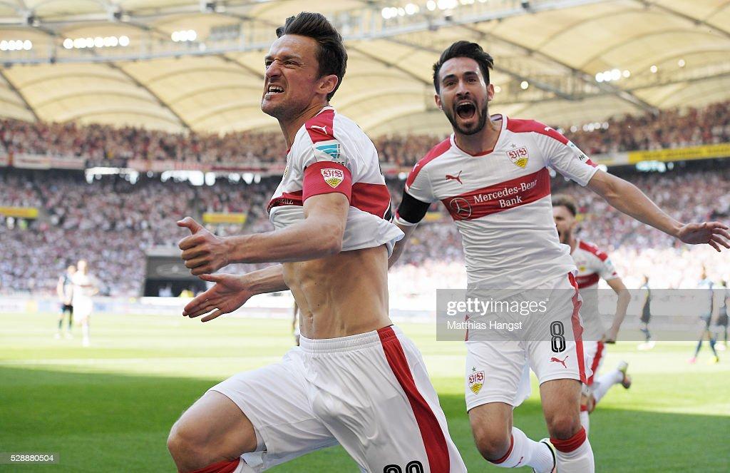 Christian Gentner of Stuttgart celebrates with his teammates after scoring his team's first goal during the Bundesliga match between VfB Stuttgart...