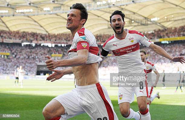 Christian Gentner of Stuttgart celebrates with his teammates after scoring his team's first goal during the Bundesliga match between VfB Stuttgart...