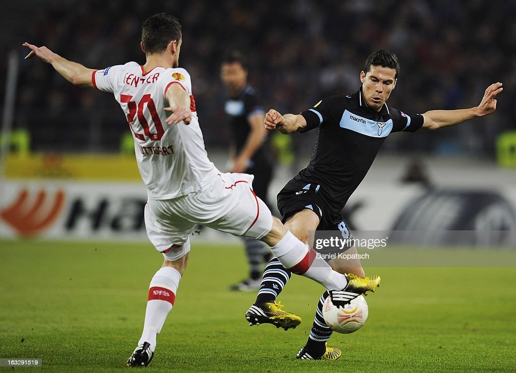 Christian Gentner of Stuttgart competes for the ball with Hernanes (R) of Lazio during the UEFA Europa League round of sixteen first leg match between VfB Stuttgart and Lazio at Mercedes-Benz Arena on March 7, 2013 in Stuttgart, Germany.