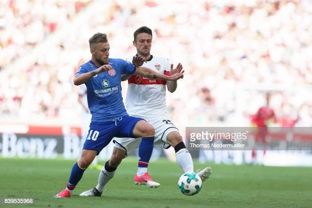 Christian Gentner of Stuttgart fights for the ball with Alexandru Maxim of Mainz during the Bundesliga match between VfB Stuttgart and 1 FSV Mainz 05...