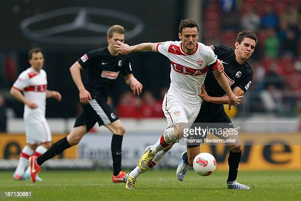 Christian Gentner of Stuttgart fights for the ball with Johannes Flum of Freiburg during the Bundesliga match between VfB Stuttgart and SC Freiburg...