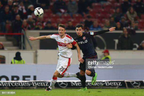Christian Gentner of Stuttgart fights for the ball with Kaan Ayhan of Duesseldorf during the Second Bundesliga match between VfB Stuttgart and...