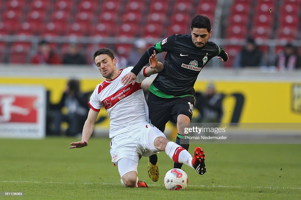 Christian Gentner (L) of Stuttgart fights for the ball with Mehmet Ekici (R) of Bremen during the Bundesliga match between VfB Stuttgart and Werder Bremen at Mercedes-Benz Arena on February 9, 2013 in Stuttgart, Germany.