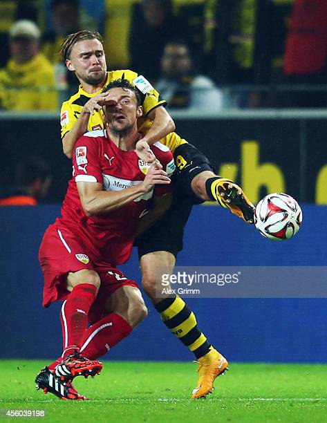Christian Gentner of Stuttgart is challenged by Marcel Schmelzer of Dortmund during the Bundesliga match between Borussia Dortmund and VfB Stuttgart...