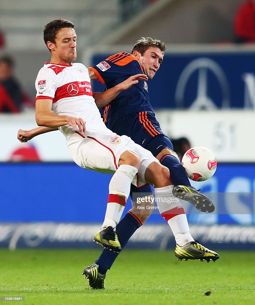 <a gi-track='captionPersonalityLinkClicked' href=/galleries/search?phrase=Christian+Gentner&family=editorial&specificpeople=228707 ng-click='$event.stopPropagation()'>Christian Gentner</a> (front) of Stuttgart is challenged by <a gi-track='captionPersonalityLinkClicked' href=/galleries/search?phrase=Stefan+Reinartz&family=editorial&specificpeople=2244849 ng-click='$event.stopPropagation()'>Stefan Reinartz</a> of Leverkusen during the Bundesliga match between VfB Stuttgart and Bayer 04 Leverkusen at Mercedes-Benz Arena on October 7, 2012 in Stuttgart, Germany.