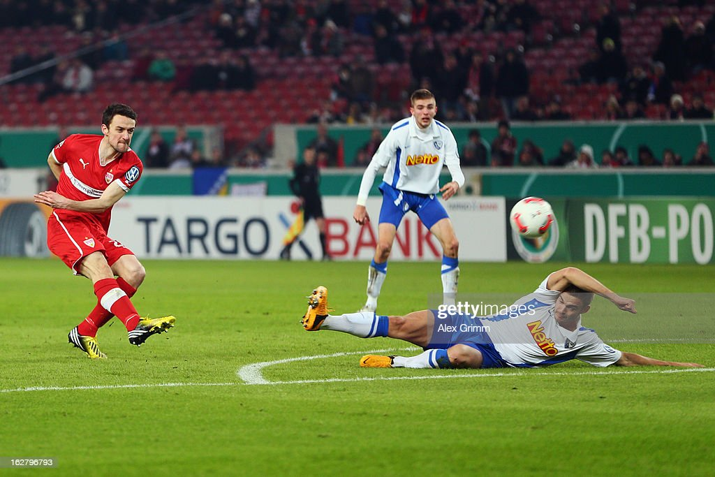 <a gi-track='captionPersonalityLinkClicked' href=/galleries/search?phrase=Christian+Gentner&family=editorial&specificpeople=228707 ng-click='$event.stopPropagation()'>Christian Gentner</a> (L) of Stuttgart scores his team's first goal against Holmar Eyjolfsson of Bochumduring the DFB Cup Quarter Final match between VfB Stuttgart and VfL Bochum at the Mercedes-Benz Arena on February 27, 2013 in Stuttgart, Germany.