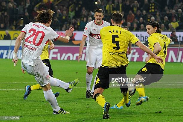 Christian Gentner of Stuttgart scores his team's fourth goal during the Bundesliga match between Borussia Dortmund and VfB Stuttgart at Signal Iduna...