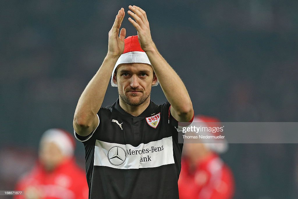 Christian Gentner of Stuttgart wears a Santa hat and applauds the fans after the DFB cup round of sixteen match between VfB Stuttgart and 1.FC Koeln at Mercedes-Benz Arena on December 19, 2012 in Stuttgart, Germany.