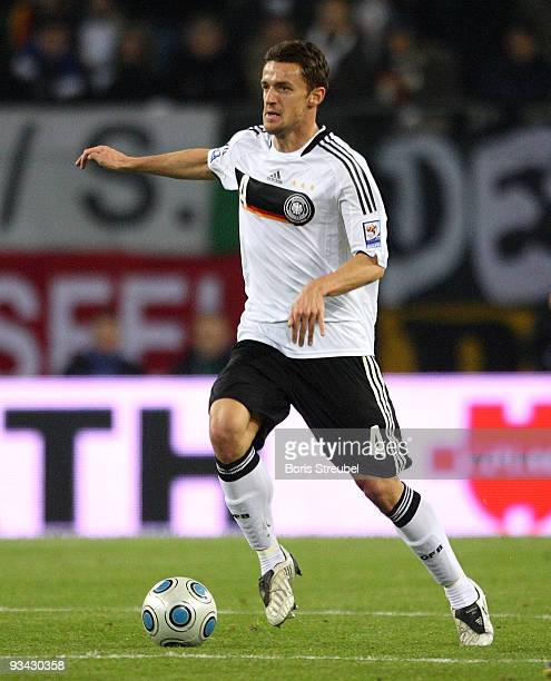 Christian Gentner runs with the ball during the FIFA 2010 World Cup Group 4 Qualifier match between Germany and Finland at the HSH Nordbank Arena on...