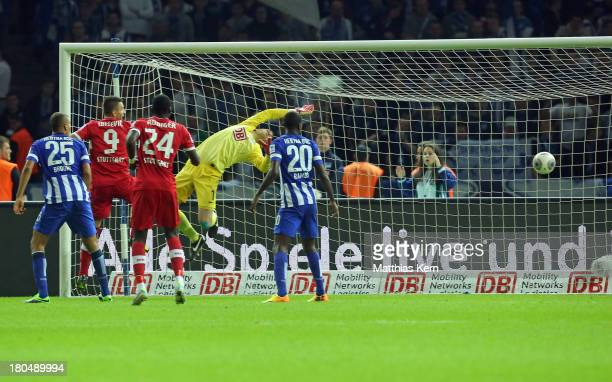 Christian Gentner scores the first goal during the Bundesliga match between Hertha BSC Berlin and VFB Stuttgart at Olympiastadion on September 13...