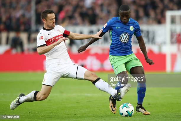 Christian Gentner of Stuttgart fights for the ball with PaulGeorges Ntep of Wolfsburg during the Bundesliga match between VfB Stuttgart and VfL...