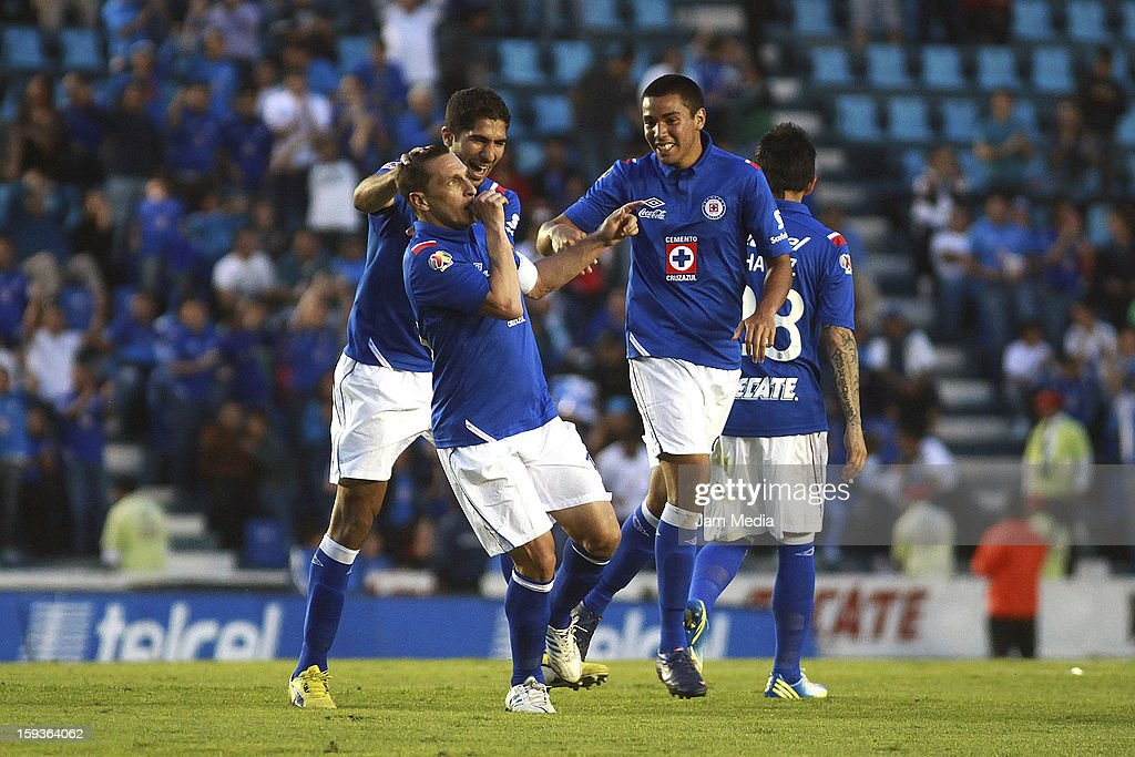 Christian Gimenez of Cruz Azul celebrates with teammates a scored goal against San Luis during a match as part of the Clausura 2013 Liga MX at Azul...