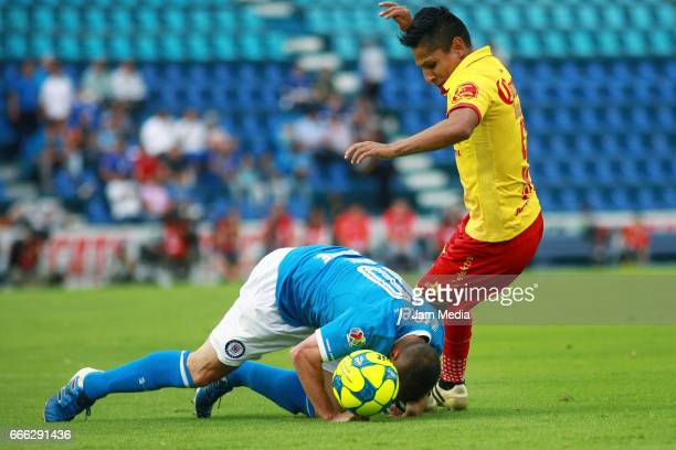 Christian Gimenez of Cruz Azul fights for the ball with Raul Ruidiaz of Morelia during the 13th round match between Cruz Azul and Morelia as par of...