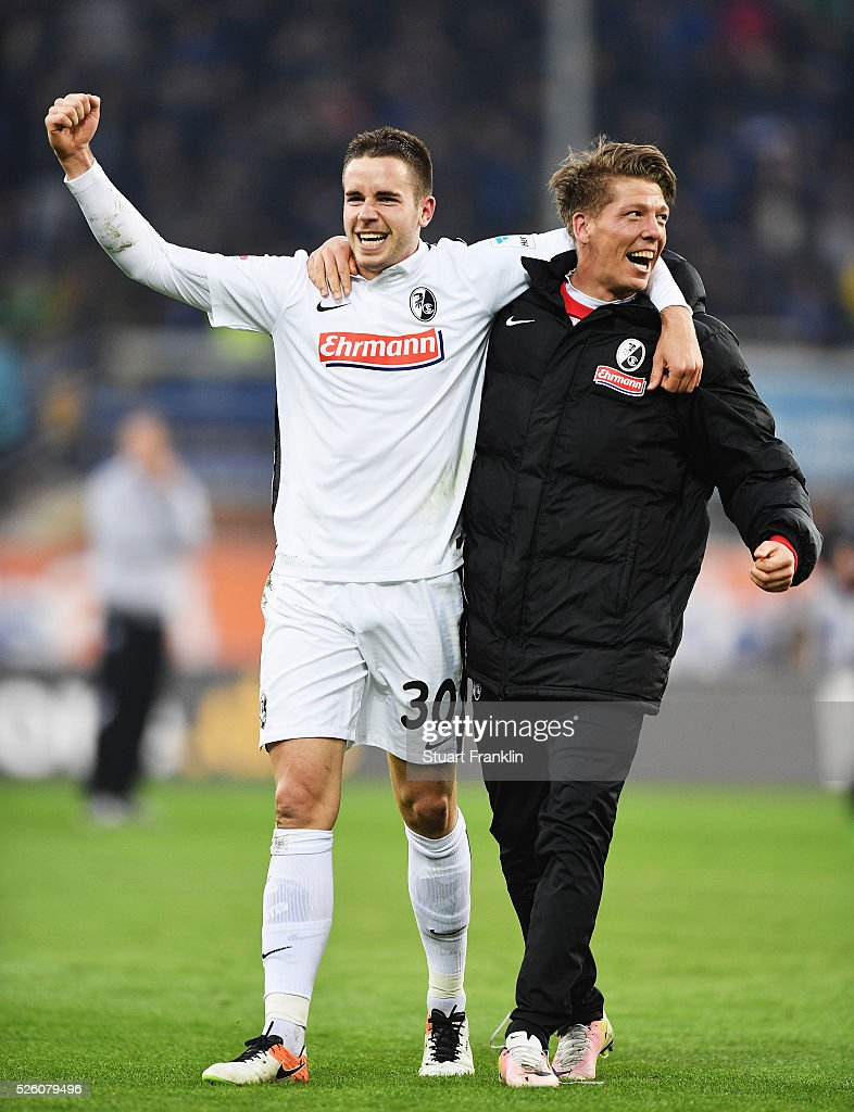 Christian G��nter and Florian Niederlechner of Freiburg celebrate promotion to the first Bundesliga after the second Bundesliga match between SC Paderborn and SC Freiburg at the Benteler Arena on April 29, 2016 in Paderborn, North Rhine-Westphalia.