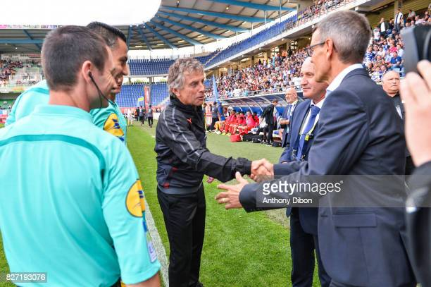 Christian Gourcuff coach of Rennes shakes hands with Jean Louis Garcia coach of Troyes during the Ligue 1 match between Troyes AC and Stade Rennais...