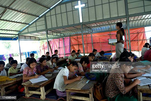 Christian group helping Karen people who survived cyclone Nargis has built a temporary school in a devastated village According to official figures...