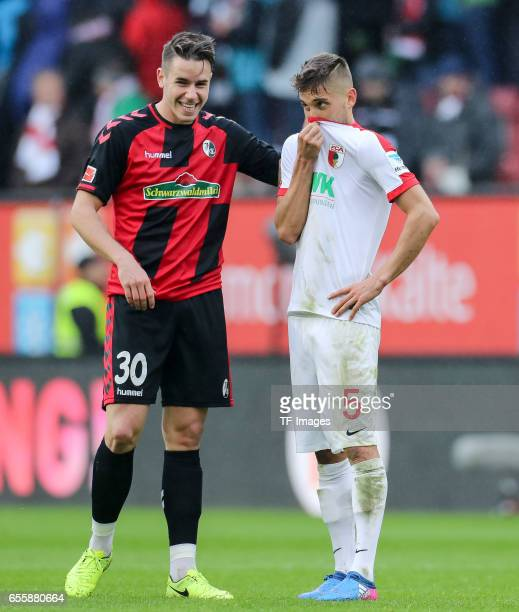 Christian Guenter of Freiburg and Moritz Leitner of Augsburg looks on during the Bundesliga match between FC Augsburg and SC Freiburg at WWK Arena on...