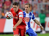 Christian Guenter of Freiburg challenges Peter Pekarik of Hertha BSC during the Bundesliga match between SC Freiburg and Hertha BSC at Mage Solar...