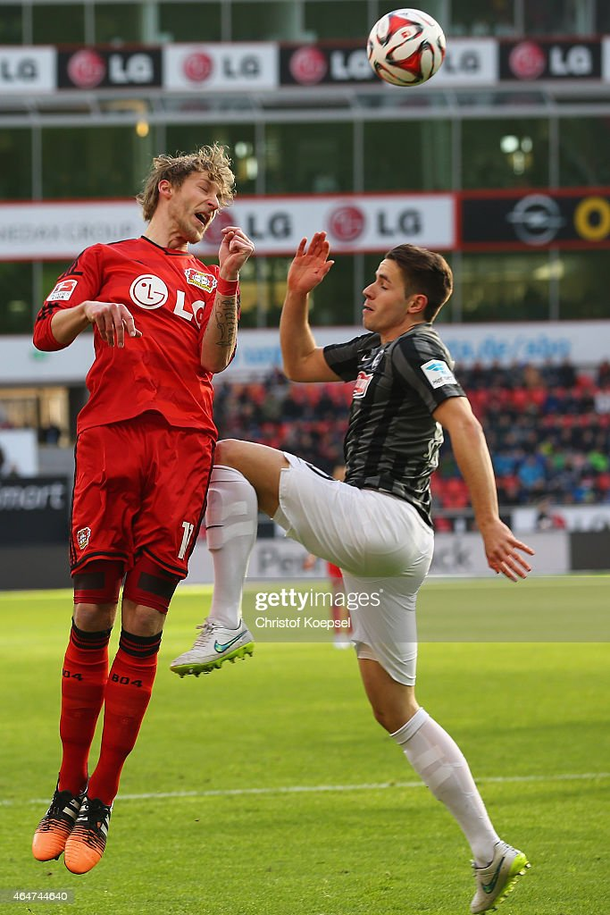 Christian Guenter of Freiburg (R) challenges Stefan Kiessling of Leverkusen (L) during the Bundesliga match between Bayer 04 Leverkusen and SC Freiburg at BayArena on February 28, 2015 in Leverkusen, Germany.
