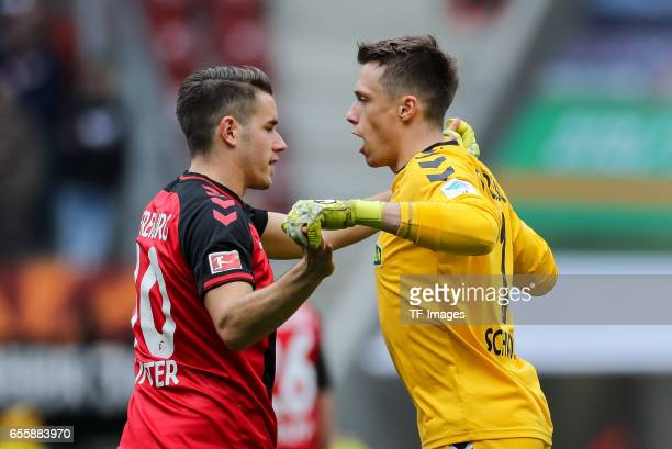 Christian Guenter of Freiburg shakes hands with Goalkeeper Alexander Schwolow of Freiburg during the Bundesliga match between FC Augsburg and SC...
