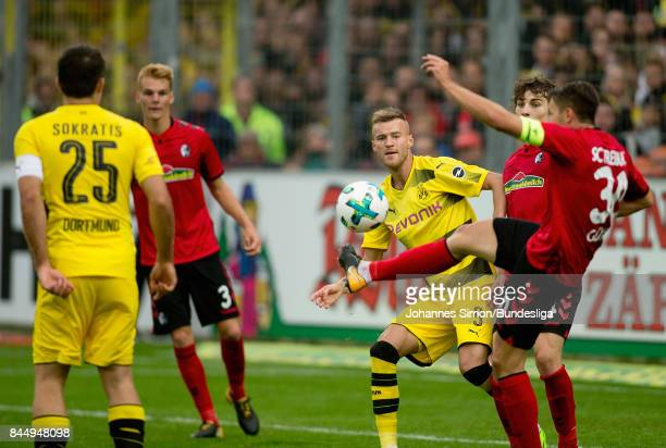 Christian Guenther of Freiburg and Andrej Yarmolenko of Dortmund fight for the ball during the Bundesliga match between SportClub Freiburg and...