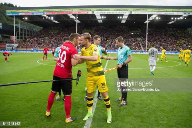 Christian Guenther of Freiburg and Marcel Schmelzer of Dortmund hugs each other prior to the Bundesliga match between SportClub Freiburg and Borussia...