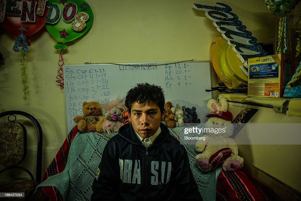Christian Gutierrez Leon, who is 14 but remains in 5th grade with 9-year-olds because he struggles in school, sits in his home in the town of La Oroya, Peru, on Wednesday, March 20, 2013. Most of La Oroyaís children suffer elevated lead levels, according to the Peruvian government. The question of responsibility for lead pollution in La Oroya is at the center of high-stakes clash between Peru and U.S. billionaire Ira Rennert, who owned Doe Run Peru for more than a decade through Renco Group Inc., a metals, mining and industrial conglomerate based in New York that has said it is not responsible for the childrenís ills. Photographer: Meridith Kohut/Bloomberg via Getty Images