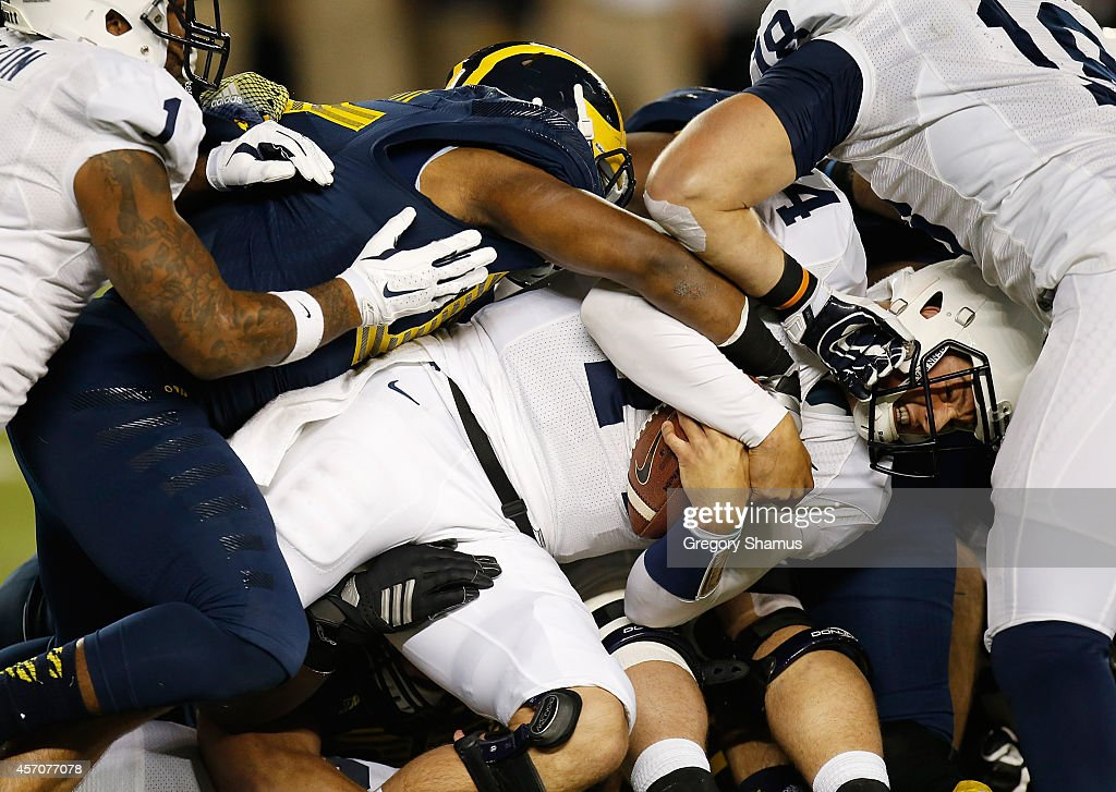 Christian Hackenberg of the Penn State Nittany Lions battles for a second quarter first down while playing the Michigan Wolverines on October 11 2014...