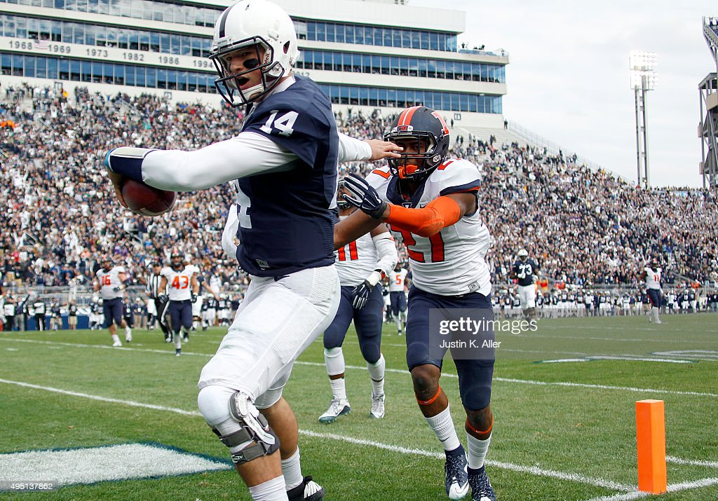 Christian Hackenberg #14 of the Penn State Nittany Lions catches a 14 yard touchdown pass in the third quarter against Eaton Spence #27 of the Illinois Fighting Illini during the game on October 31, 2015 at Beaver Stadium in State College, Pennsylvania.