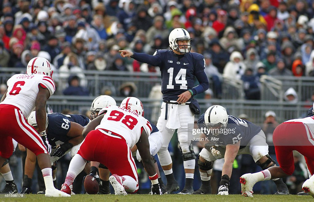 Christian Hackenberg #14 of the Penn State Nittany Lions directs the offense against the Nebraska Cornhuskers during the game on November 23, 2013 at Beaver Stadium in State College, Pennsylvania.