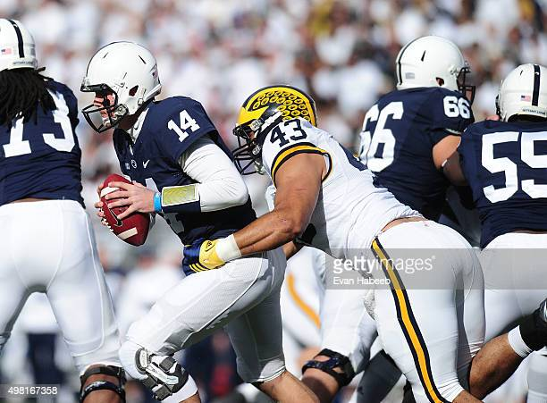 Christian Hackenberg of the Penn State Nittany Lions is sacked by Chris Wormley of the Michigan Wolverines at Beaver Stadium on November 21 2015 in...