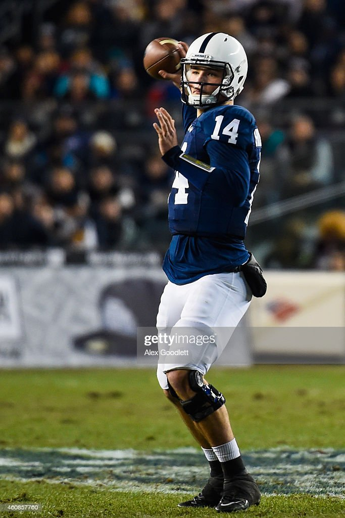 <a gi-track='captionPersonalityLinkClicked' href=/galleries/search?phrase=Christian+Hackenberg&family=editorial&specificpeople=11321709 ng-click='$event.stopPropagation()'>Christian Hackenberg</a> #14 of the Penn State Nittany Lions looks for a pass in the first quarter during a game against the Boston College Eagles in the 2014 New Era Pinstripe Bowl at Yankee Stadium on December 27, 2014 in the Bronx borough of New York City.