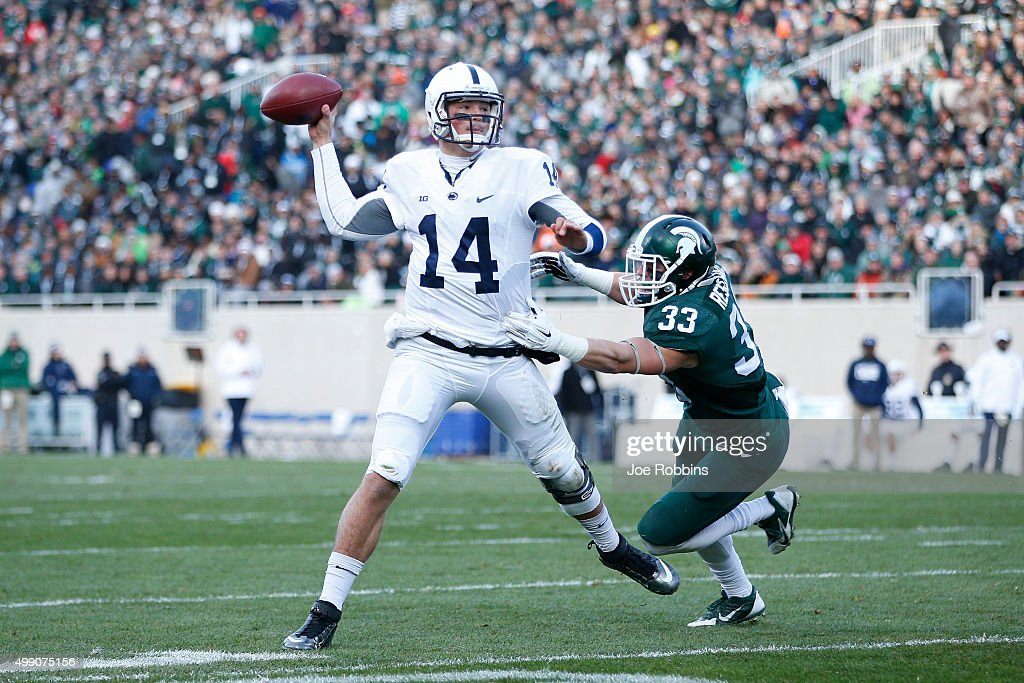 <a gi-track='captionPersonalityLinkClicked' href=/galleries/search?phrase=Christian+Hackenberg&family=editorial&specificpeople=11321709 ng-click='$event.stopPropagation()'>Christian Hackenberg</a> #14 of the Penn State Nittany Lions passes while under pressure from Jon Reschke #33 of the Michigan State Spartans in the first half of the game at Spartan Stadium on November 28, 2015 in East Lansing, Michigan.