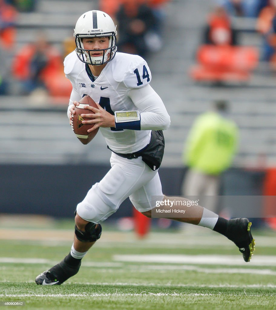 <a gi-track='captionPersonalityLinkClicked' href=/galleries/search?phrase=Christian+Hackenberg&family=editorial&specificpeople=11321709 ng-click='$event.stopPropagation()'>Christian Hackenberg</a> #14 of the Penn State Nittany Lions scrambles out of the pocket during the game against the Illinois Fighting Illini at Memorial Stadium on November 22, 2014 in Champaign, Illinois.