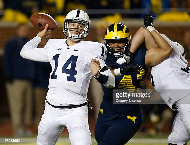 Christian Hackenberg of the Penn State Nittany Lions throws a third quarter pass in front of Chris Wormley of the Michigan Wolverines on October 11...