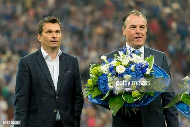 Christian Heidel of Schalke and Clemens Toennies looks on during to the Bundesliga match between FC Schalke 04 and Hamburger SV at VeltinsArena on...