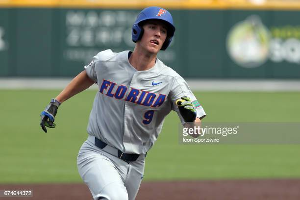 Christian Hicks of the Gators hustles around the bases during the college baseball game between the Florida Gators and the Vanderbilt Commodores on...