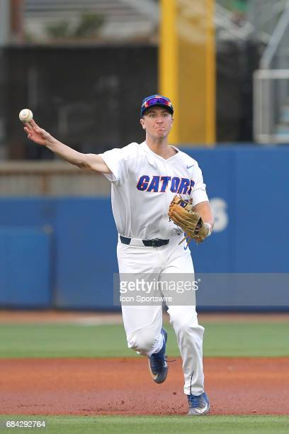 Christian Hicks of the Gators throws the ball over to first base during the college baseball game between the Ole Miss Rebels and the Florida Gators...